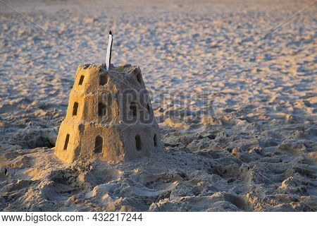 Sand Buildings On The Beach In The Form Of Gediminas Tower