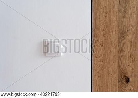 Nobody At Home Interior, Light Switch At Wall. Modern House Plastic Button For Electricity Power Con