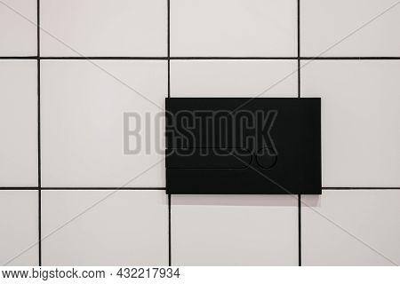 Closeup At Bathroom Design, Clean Toilet Button. Modern Minimalistic Interior With Sanitary Push Equ