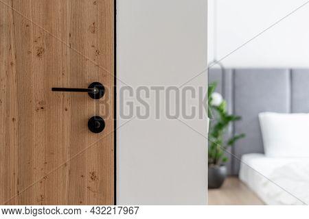 Closeup At Door Design, Open Room Interior. Minimalist House Style With Doorknob, Handle At Wooden D