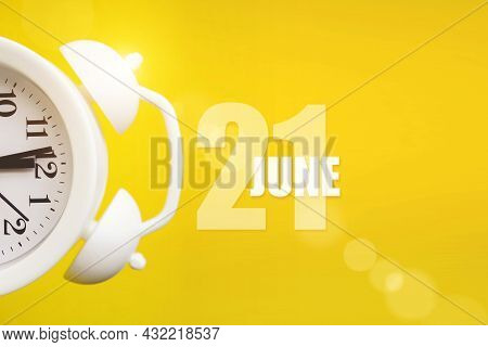 June 21st . Day 21 Of Month, Calendar Date. White Alarm Clock On Yellow Background With Calendar Day