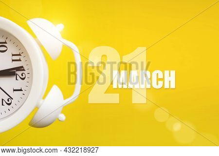 March 21st . Day 21 Of Month, Calendar Date. White Alarm Clock On Yellow Background With Calendar Da