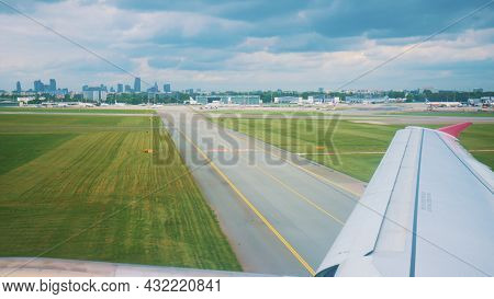 A Passenger Airplane Taxiing Runway After Landing At The Airport. Wing Of A Flying Airplane Landing