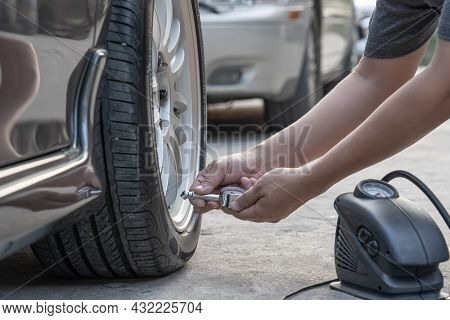Asia Man Use Tire Gauge Analog Check Air Pressure Of Wheel Car On The Road Basic Maintenance By Ones
