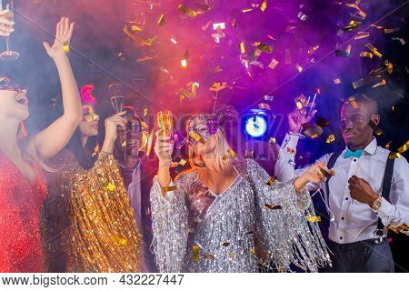 People Dance At Party In Nightclub, Drink Champagne In Falling Confetti