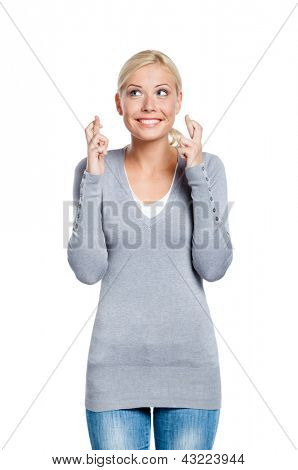 Lady with fingers crossed, isolated on white. Concept of wishing or praying about something