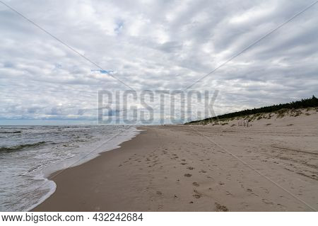 Pristine Empty Sand Beaches With Forest And Sand Dunes On The Shore