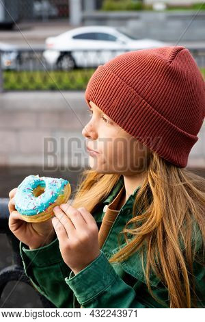 Boy With Long Red Hair In The City On The Waterfront.buttons Green Shirt. Concept Of Urban Life.enjo