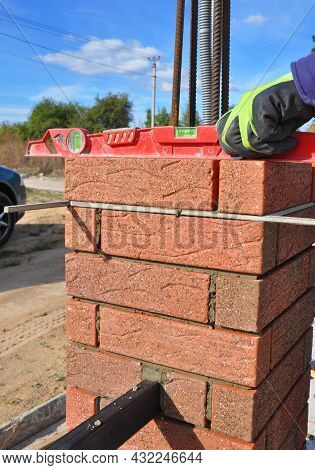 Brick Fence Pillar, Column Construction With Steel Rebars And Vertical Bracing Attached. A Building