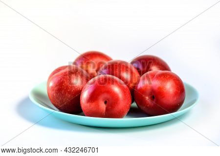 Raw Organic Red Plums On White Background, Fresh Shiny Fruits. Farm Fresh Organic Red Plums Produce