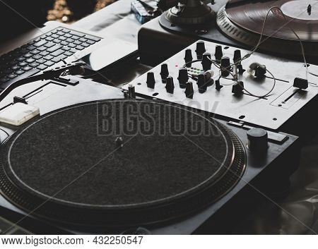 Dj Playing Music At A Hip Hop Party. Analog Turntable, Dj Uses Turntable And Mixer For Scratching.