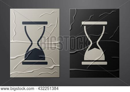 White Old Hourglass With Flowing Sand Icon Isolated On Crumpled Paper Background. Sand Clock Sign. B