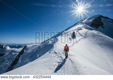 Before Mont Blanc (monte Bianco) Summit 4808m Last Ascending. Team Roping Up Man With Climbing Axe D