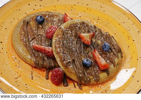 Healthy Summer Breakfast,homemade Classic American Pancakes With Fresh Berry And Nutella