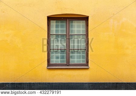 Double Casement Window On Yellow Concrete Wall Of House Building. Architecture Background
