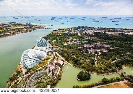 SINGAPORE, SINGAPORE - MARCH 2019: aerial view of Singapore City skyline with Gardens by the Bay