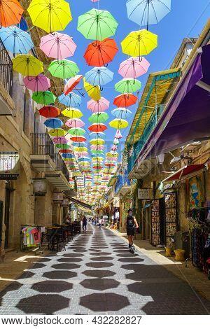 Jerusalem, Israel - August 30, 2021: Pedestrians And Colorful Umbrellas (parasols), In Yoel Moshe So