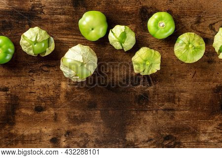 Tomatillos, Green Tomatoes, Shot From The Top With A Place For Text. Mexican Food Ingredient On A Da