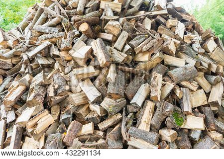 Fuel And Heat Source For The Winter Season.preparing For The Firewood Heating Season. Chopped Firewo