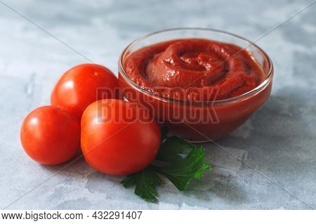 Tomato Paste With Fresh Tomatoes On Gray Background.