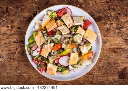 Syrian And Lebanese Vegetable Salad With Pita Fattoush In A Plate, Top View
