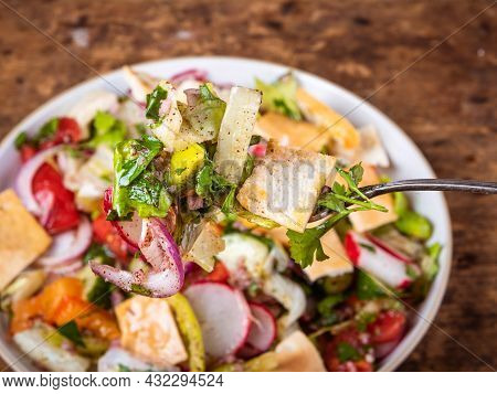 Fork With Syrian And Lebanese Vegetable Salad With Pita Fattoush On The Background Of A Plate With A