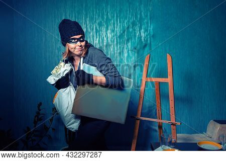 A Masked Female Robber Is Carrying A Stolen Bag Of Money And A Painting. The Background Is Dark Blue