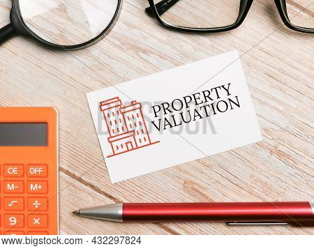 Mortgage Concept. Phrase Property Valuation Written On White Card.