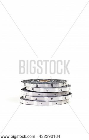 Professional Tailoring Equipment In The Form Of Silver Coils With Size Tags And The Inscription Of S