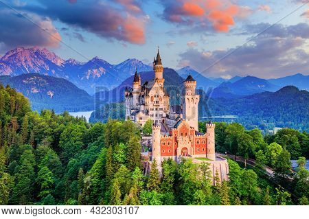 Neuschwanstein Castle, Germany. Front View Of The Castle And The Bavarian Alps At Sunrise.
