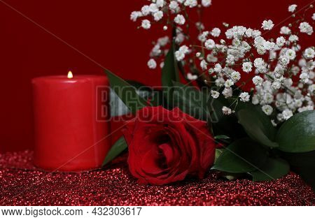 Red Rose With Red Candle On Red Velvet Background