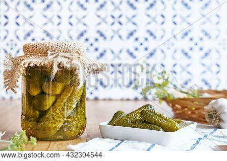 Salted Pickled Cucumbers Preserved Canned In Glass Jar. Plate Of Pickled Homemade Gherkins With Fres