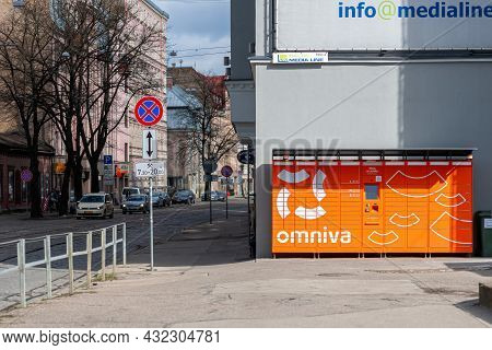 Riga, Latvia - 7 April, 2021:omniva Terminal For Automatic Parcel Delivery With Many Drawers For Par