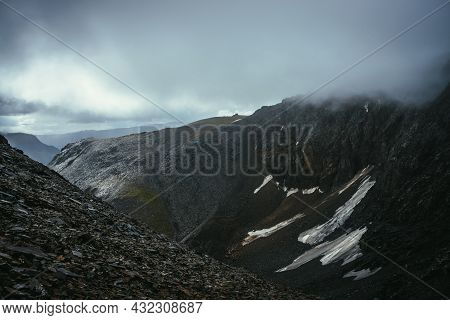 Dark Atmospheric Landscape On Edge Of Abyss In Highlands. Dangerous Mountains And Abyss In Overcast