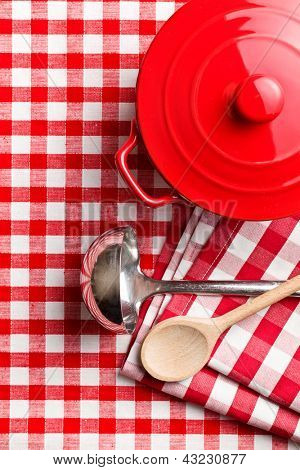 the kitchenware on checkerd tablecloth
