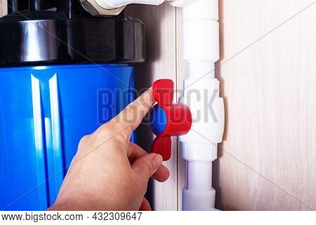 Red Plastic Faucet On White Water Pipe. Home Water Filtration System. Stationary Cleaning And Filtra