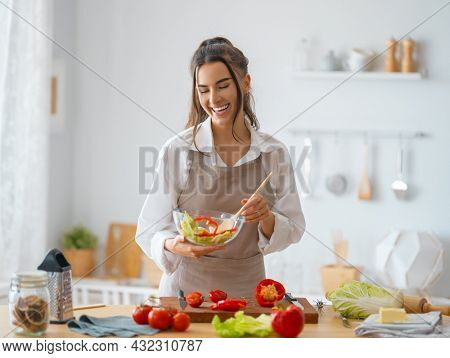 Healthy food at home. Woman is preparing the proper meal in the kitchen.