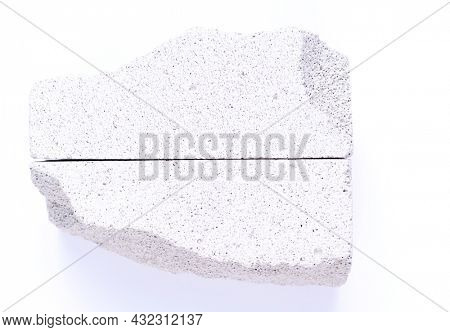 Aerated concrete piece of block isolated on white background. Lightweight concrete texture surface