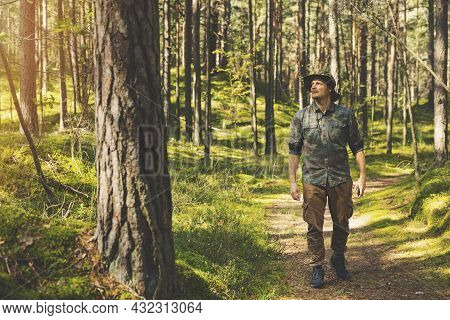 Forest Ranger Or Forester On The Walk