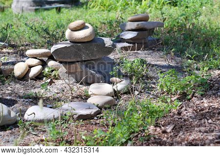 A Stack Of Flat Gray Stones In The Recreation Area On The Lawn. Selective Focus.