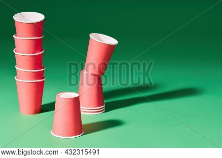 Set Of Red Paper Cups On Green Background With Copy Space