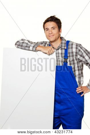 a young craftsman, plumber, construction worker with empty poster