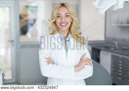 Cheerful Beautiful Woman Doctor Posing At Newest Dental Clinic