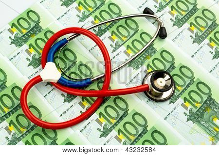 stethoscope and euro banknotes. symbolic photo for health care costs and health insurance and medical