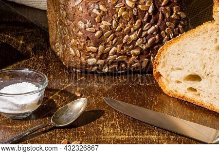 Still Life - Yeast-free Buckwheat Bread, Black Bread With Sunflower Seeds, Coarse Salt In Glass Jar,