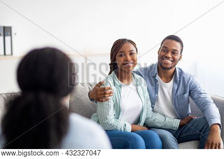 Happy Married Couple After Successful Psychotherapy At Marital Counselors Office