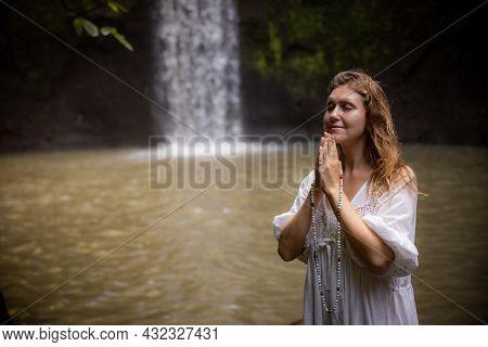 Caucasian Woman Keeping Count During Pray And Meditation. Buddhist Japa Mala. Strands Of Gemstones B