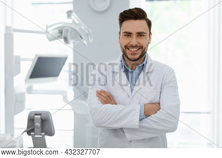 Cheerful Man Doctor Posing At Newest Dental Clinic