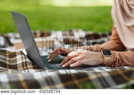 Unrecognizable Young Arabian Female In Hijab Typing On Laptop, Surfing In Internet, Checks Social Ne