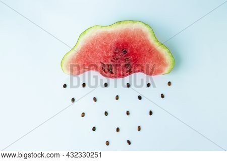 Watermelon Rain, Slice Of Watermelon In The Shape Of A Cloud With Seeds As Raindrops. Autumn Or Summ